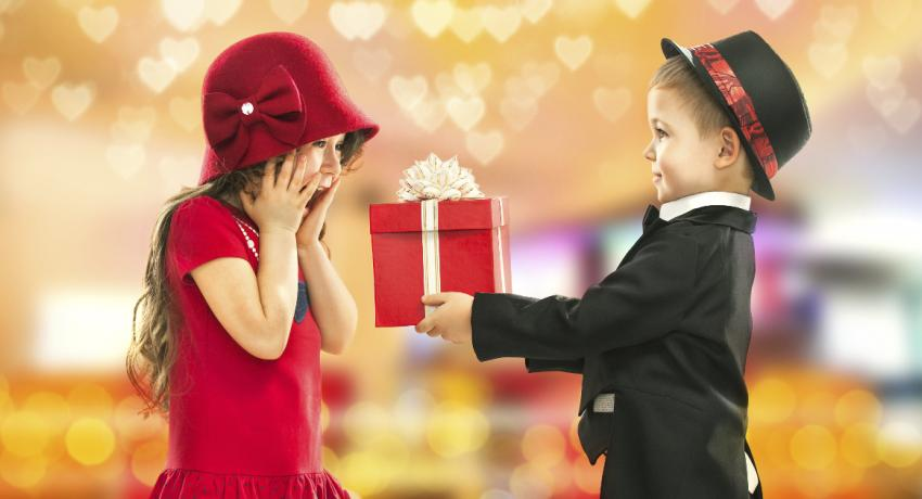 Boy giving a present to a girl for Valentine's Day