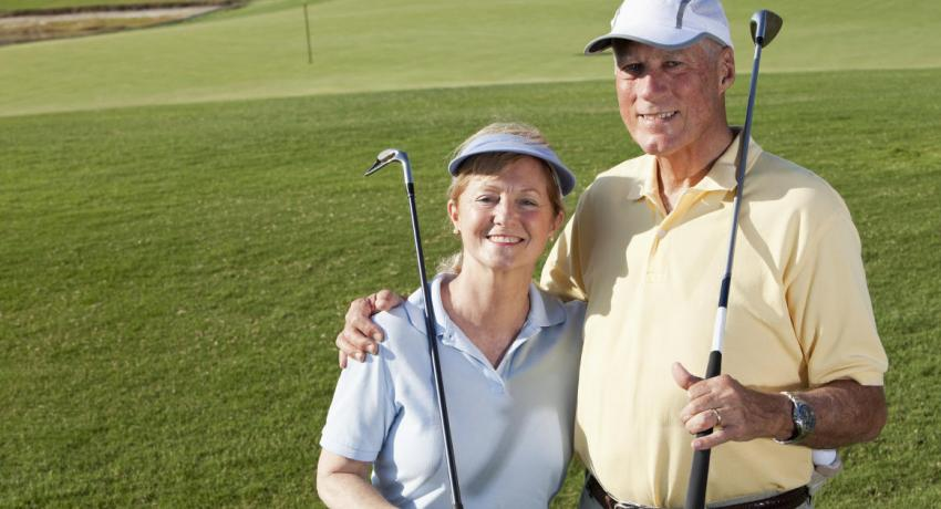 Retired couple golfing thanks to carefully planning for their retirement goals