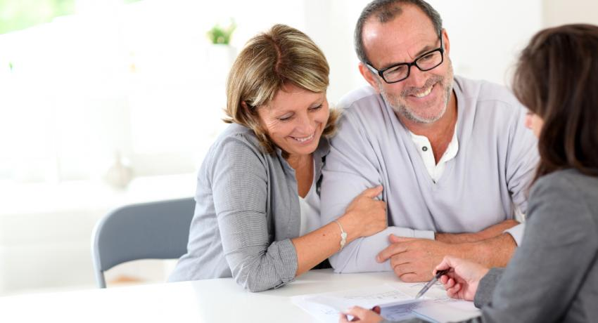 Couple meeting with advisor, what retirement means for you